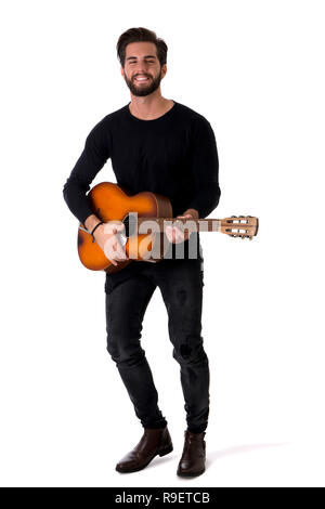 Full Length Portrait of Young Man Playing Guitar in Studio - Stock Photo