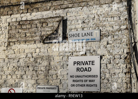 Shoe Lane street sign, Westcliff on Sea, Essex, UK. New road sign on old wall with decaying vintage sign - Stock Photo