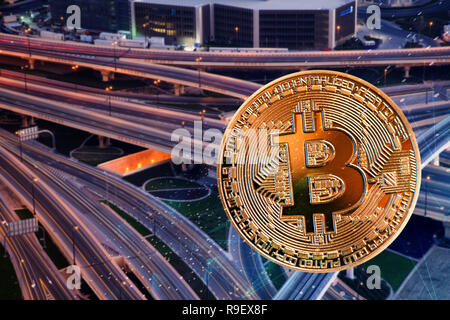 bitcoin against skyscrapers - futuristic smart city - cryptocurrency concept - Stock Photo