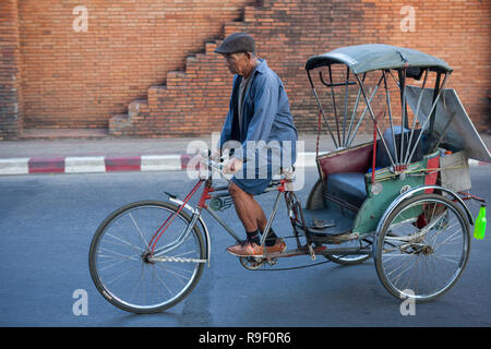 Bicycle rickshaw, Mun Mueang Road, Chiang Mai, Thailand - Stock Photo