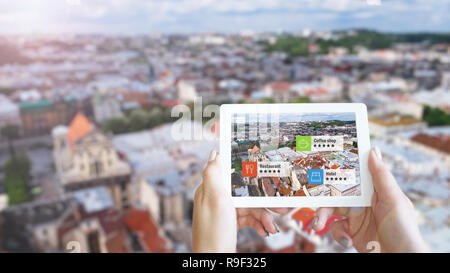 Augmented reality marketing concept. Hand holding tablet use AR application - Stock Photo