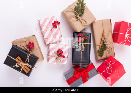 A lot of christmas presents isolated on white background. Multiple new years gifts in different wrapping. Top view. - Stock Photo