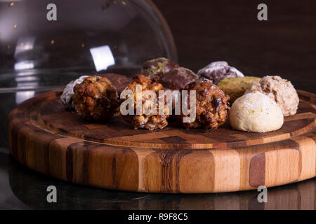 Variety of cookies on wooden plate - Stock Photo