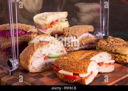 Beautifully decorated catering banquet table with different food snacks and appetizers with sandwich, on corporate christmas birthday kids party event - Stock Photo