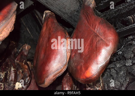 Drying ham inside an old house, Montenegro - Stock Photo