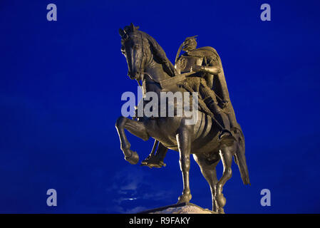 Night view of statue of Skanderberg in Skanderbeg Square, Tirana, Albania - Stock Photo