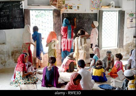Varanasi / India 20 September 2011 Muslim teacher with children in classroom Islamic school at Varanasi Uttar Pradesh India - Stock Photo