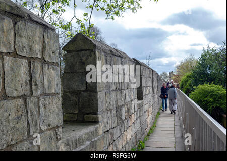 Elevated walkway on York City Walls, (Bar Walls or Roman walls), ancient monument encircling historic City of York, England, UK - Stock Photo
