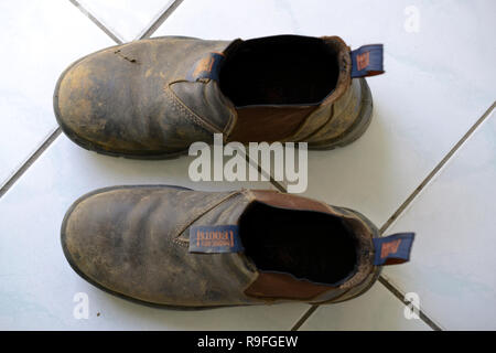 Work boots from above - Stock Photo