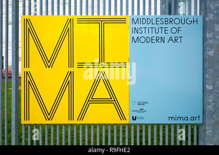 A sign for MIMA The Middlesbrough Institute of Modern Art mounted on a fence - Stock Photo