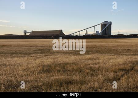 Coal silos and coal train loading and processing facilities in the Powder River Basin, Wyoming / USA. - Stock Photo