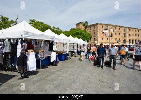 A row of stalls selling all sorts of art and craft along the promenade near the Museum of the History of Catalonia in Barcelona, Spain - Stock Photo