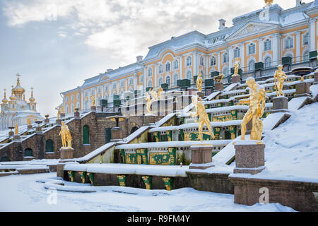 SAINT PETERSBURG, RUSSIA - JANUARY 22, 2018: Peterhof in winter. Statues of the Grand Cascade covered with snow - Stock Photo