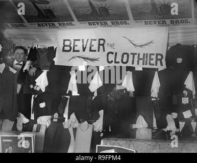 Bever the Clothier poses with his inventory at his shop in Pawnee City, Nebraska, ca. 1905. - Stock Photo