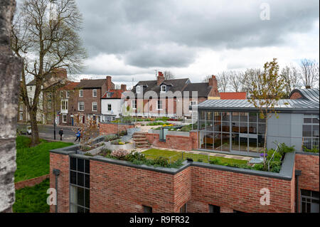 York, England - April 2018: Brick and stone buildings in old town seen from York City Walls in City of York, England, UK - Stock Photo