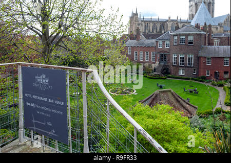 York, England - April 2018: Old building of Grays Court Hotel and Restaurant in old town seen from York City Walls in City of York, England, UK - Stock Photo
