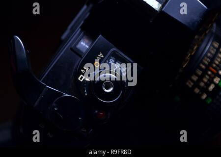 Close up shot of the Shutterspeed dial, shutter button and film advance crank of a 35mm film camera - Stock Photo