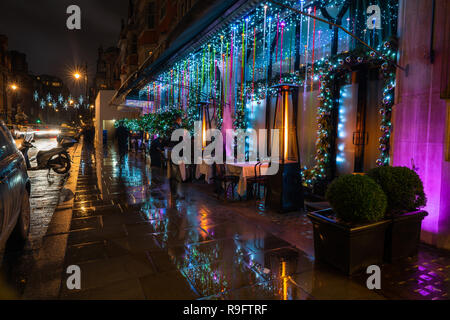 LONDON - DECEMBER 23, 2018: Shops and restaurands on Mount Street in Mayfair, luxury shopping district in London situated between South Audley Street  - Stock Photo