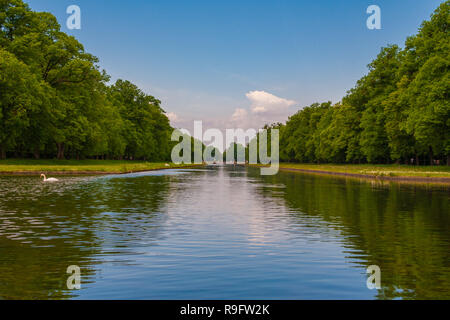 Beautiful panoramic view of the central canal of Munich's famous Nymphenburg Palace. A swan is swimming on the canal which is still a visible feature... - Stock Photo