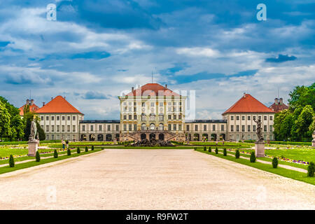 Lovely back view of the Nymphenburg Palace and the Grand Parterre with fountain and the gravel path in the centre leading to the baroque palace. The... - Stock Photo