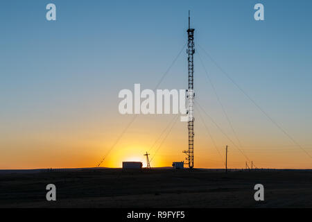 cell phone tower at sunset - Stock Photo