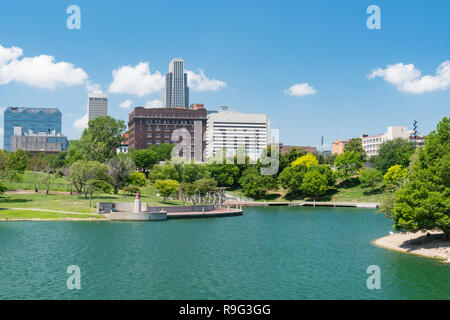 City skyline of Omaha Nebraska from the Heartland of America Park - Stock Photo