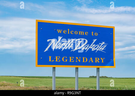 North Dakota welcome sign along the highway at the state border - Stock Photo