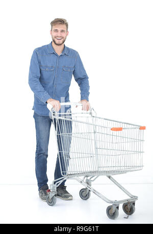 successful young man with a shopping cart - Stock Photo