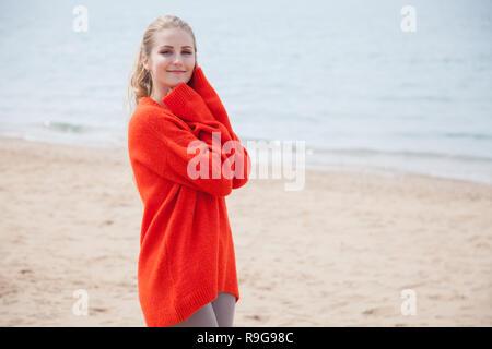 beautiful blonde woman walking on the sandy sea-Beach - Stock Photo