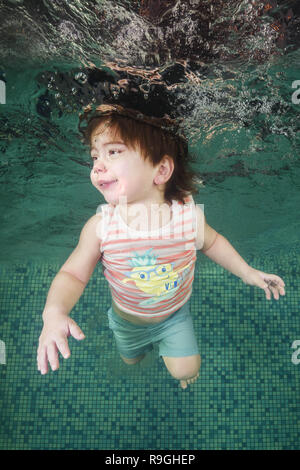 December 15, 2018 - Odessa, Ukraine, Europe - A little boy learns to swim underwater in the pool. Healthy family lifestyle and children water sports activity. Child development, disease prevention (Credit Image: © Andrey Nekrasov/ZUMA Wire) - Stock Photo