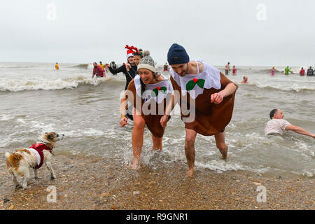 Charmouth, Dorset, UK. 25th Dec, 2018. Christmas day swimmers wearing fancy dress braving the chilly water to take a dip in the sea at Charmouth in Dorset to raise money for the RNLI. Picture Credit: Graham Hunt/Alamy Live News - Stock Photo