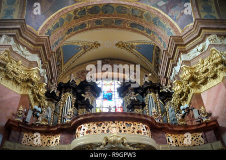 Olomouc, Czech Republic. 25th Dec, 2018. Church of Saint Michael is a Roman Catholic church in Olomouc in the Czech Republic. The church, connected originally with the Dominican Order, was constructed in the 13th century and reconstructed to its current Baroque form in 1676-1703 by Giovanni Pietro Tencalla. Stucco ornamentation of the interior was provided by Baltazar Fontana. The church is characterised by its three domes symbolizing the saint Holy Trinity. Bottom side of all domes is covered by frescos. Church organ are original from 1706, made by David Sieber, organist from Brno. (Cred - Stock Photo