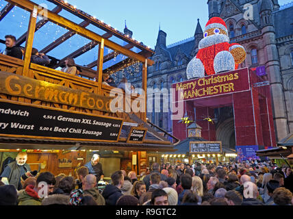 German Food, Christmas markets, Albert Square, Manchester, Lancashire, north West England, UK, at dusk - Stock Photo