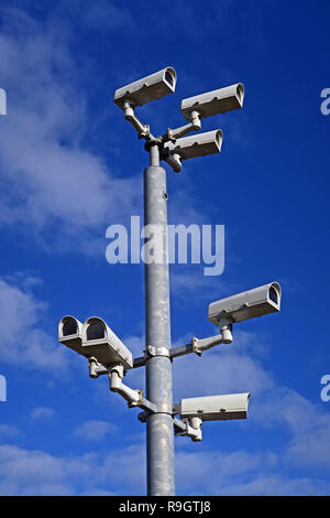 Seven Security Surveillance Closed Circuit AI Cameras, on a pole in a town centre, UK