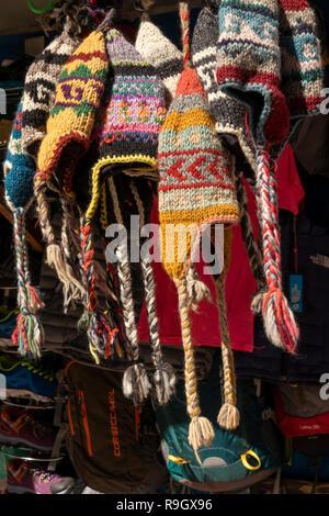 Nepal, Everest Base Camp Trek, Khumjung village, hand knitted warm woolen hats for sale on souvenir stall - Stock Photo