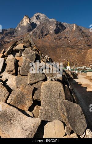 Nepal, Everest Base Camp Trek, Khumjung, traditional carved mani stones below Mount Thame (3650m) - Stock Photo