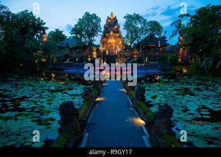 Evening atmosfere iof the Pura Saraswati Temple with beatiful lotus pond, Ubud, Bali in Indonesia - Stock Photo