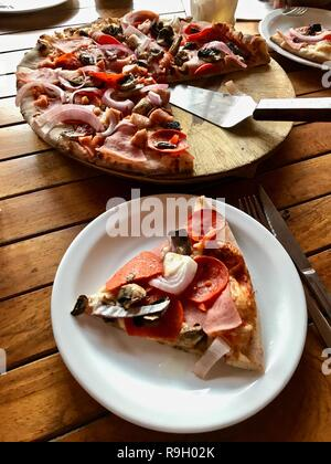 Gourmet pizza on a wooden table - Stock Photo