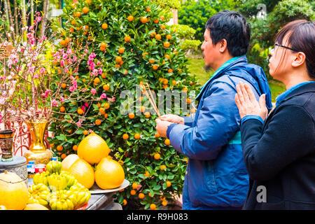 Hanoi, Vietnam - Feb 13, 2018: Asian people praying at temple in Hanoi. - Stock Photo