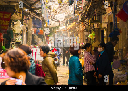 Hanoi, Vietnam - Feb 13, 2018: Street sellers of Hanoi city, Most of the street sellers use bicycle to sell their product like fruits, flowers or othe - Stock Photo