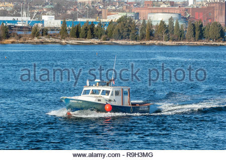 New Bedford, Massachusetts, USA - December 11, 2018: Lobster boat Honi-Do leaving New Bedford with Palmer Island in background - Stock Photo