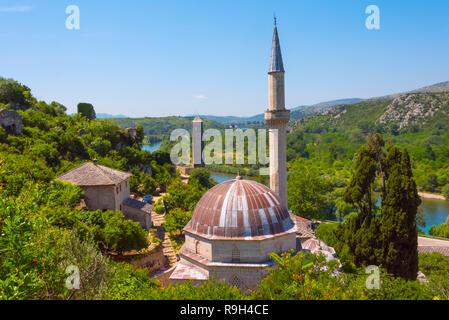 Hajji Alija Mosque overlooking the Neretva River, Pocitelj, Bosnia and Herzegovina - Stock Photo