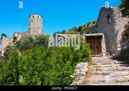 Tower of the Kula and old house, Pocitelj, Bosnia and Herzegovina - Stock Photo