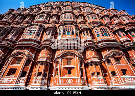Hawa Mahal facade with many windows and balconies at blue sky in Jaipur Rajasthan, India - Stock Photo