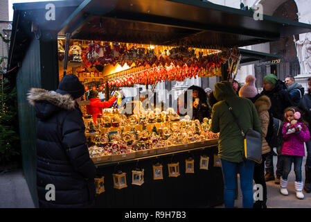 Salzburg,Austria-December 11,2018: People walk in Salzburg's Christkindlmarkt Christmas Market looking at the wares in display in the different stalls - Stock Photo