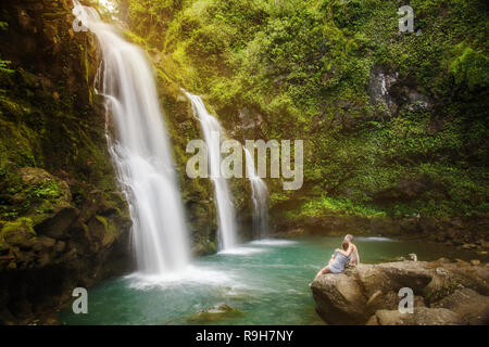 Upper Waikani Falls Hawaii couple in love romantic getaway - Stock Photo