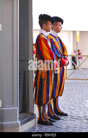 ROME, ITALY - OCTOBER 26: Swiss Guard in Vatican on OCTOBER 26, 2009. Two members of the Pontifical Swiss Guard at entrance in Vatican. - Stock Photo
