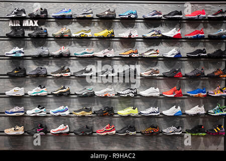 A display of Nike Air Max athletic shoes for sale at Footaction on West 34th Street in Manhattan, New York City. - Stock Photo