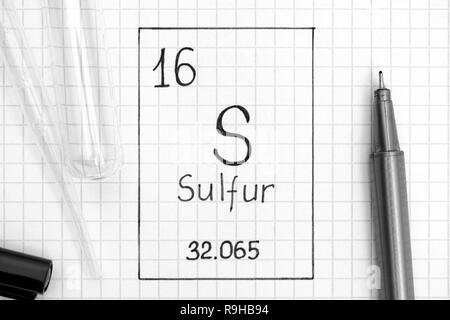 The Periodic table of elements. Handwriting chemical element Sulfur S with black pen, test tube and pipette. Close-up. - Stock Photo