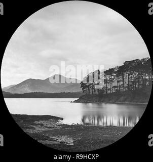 A late Victorian black and white photograph of Friar's Crag, a promontory jutting out into Derwentwater in the Lake District National Park in Cumbria, England. - Stock Photo
